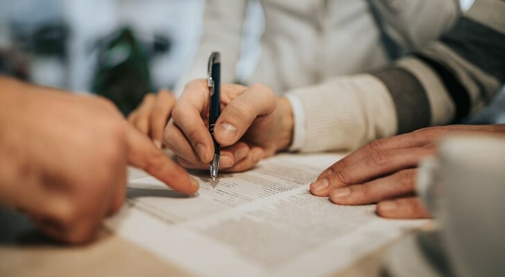 Buyers sign a purchase agreement for a new house